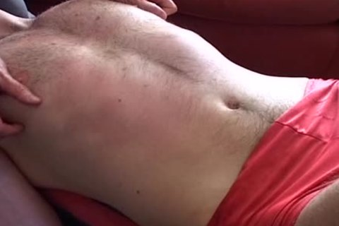 Me  Filming Two Other boyz To Make A (hopefully) Erotic 10-Pounder Massage video scene. The Red Shorts Are Mine - But They Had To Be Thrown Out because Baby-oil Ruined 'em Over A Period Of Time. u Can watch The Holes Appearing In 'em.  Tip: Use Water