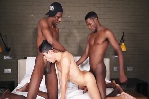 A favourable naughty twinks gets Two Large Dicked Hunky black men Who pound Him