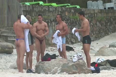 Bodybuilders In belts At Beach