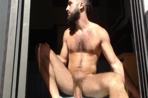 Bearded lad Massages his balls